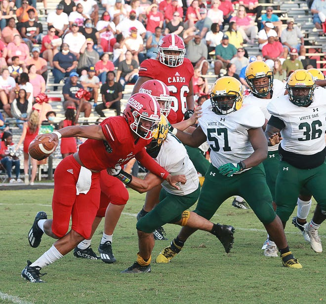 Jacksonville quarterback Josh Benton had two rushing touchdowns and two passing touchdowns Friday in a 48-6 win over White Oak.