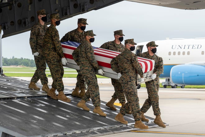 A U.S. Marine Corps carry team transfers the remains of Marine Corps Sgt. Nicole L. Gee at Dover Air Force Base, on Aug. 29, 2021. Gee was assigned to Combat Logistics Battalion 24 out of Camp Lejeune.