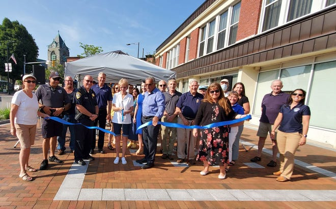 The ceremonial ribbon is cut Wednesday, Aug. 25 to open the new park in front of the Woodblock Building in downtown Leominster.