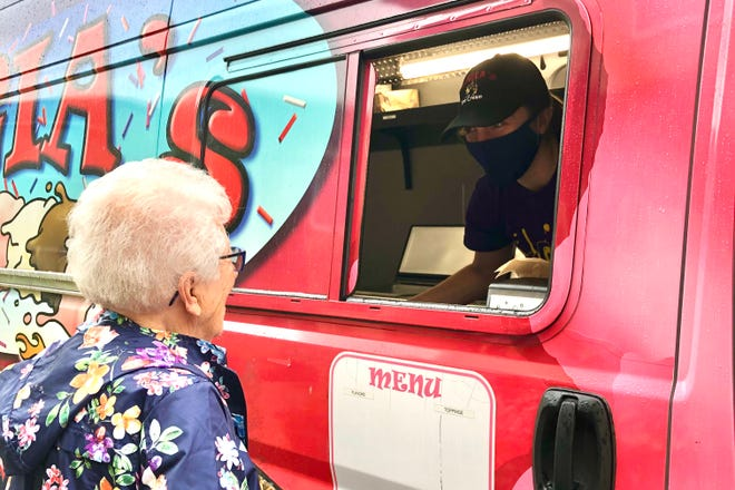 Christine Dziuba celebrates her 97th birthday at Beatrice Place on Denise Road. She and her family treated residents to Luiga's Ice Cream.