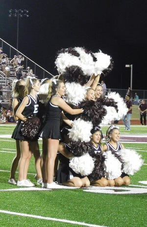 """Ennis High School cheerleaders make their """"Big E"""" out of their pom-poms during Friday night's season-opening football game against Red Oak."""