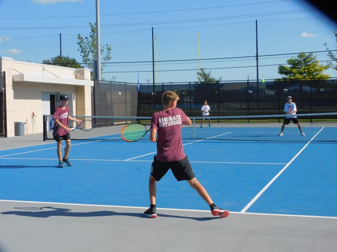Midlothian High School boys' doubles tennis players (in foreground) take on Ennis during a fall team match last week.