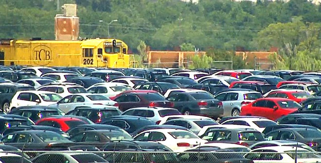Hundreds of imported cars await transport to dealerships at MidTexas International Center Inc. in Midlothian in 2017. The facility wants to expand its storage capacity temporarily by using a pasture at the northeast corner of Midlothian Parkway and FM 1387.