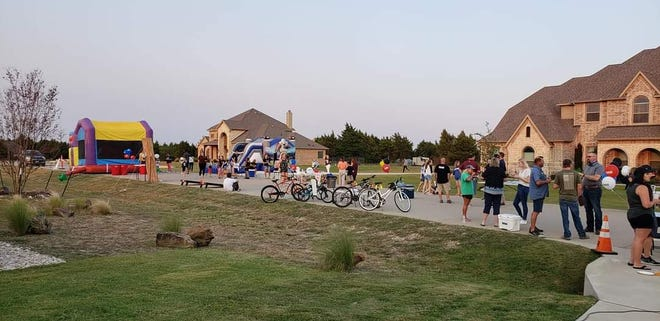 The Four Trees neighborhood in Midlothian conducts a National Night Out block party last October. The city's NNO Kick-Off will be held on Saturday, Sept. 11 during the city's Heritage Day celebration and this year's neighborhood event will take place Tuesday, Oct. 5.