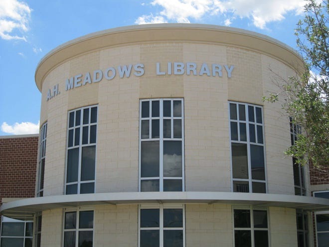 The exterior of A.H. Meadows Library, which is located at Midlothian High School. The library is open to the public, but patrons must show identification during school hours.