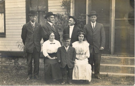 Elmer Beverly (bottom, center) poses for a photo with his family around 1925. Back row, from left: Jim Collins, Arza Van Wormer; Guy Van Wormer; and Ernest Schnurstein. Front row: Jim's wife Mabel Collins, Beverly, and Ernie's wife Faye Schnurstein.