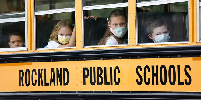 Students arrive at the Jefferson School in Rockland, where masks are required  both on the bus and in school, on Monday, Aug. 30, 2021.