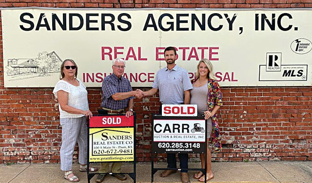 (From left) Denise Sanders, Rich Sanders, Chris Froetschner, Jamie Froetschner have made a deal that will continue generational auction and real estate sales service in Pratt County.