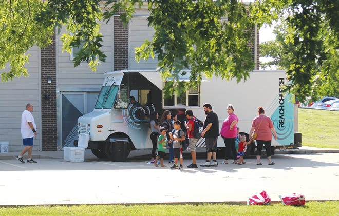 A Reach Church food truck provides treats to families participating in the annual school supplies and backpack giveaway in Pratt.