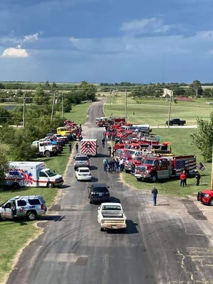 Fire department representatives from around south-central Kansas paid tribute to their fallen comrade, Mullinville Fire Chief Cody Sherer on August 20, 2021 in Kiowa County.