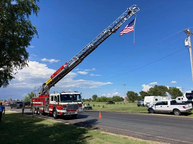 The ladder truck from City of Pratt Fire Department presented the flag in honor of Mullinville's Fire Chief Cody Sherer who passed away earlier in August this year.