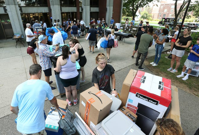 Students wait to enter McVinney Hall while preparing to move into Providence College on Aug. 26.