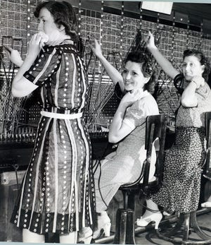 In August 1939 in Providence, telephone operators Helen Egan, Eva DeSimone and Frances Perrotti work at the switchboard.