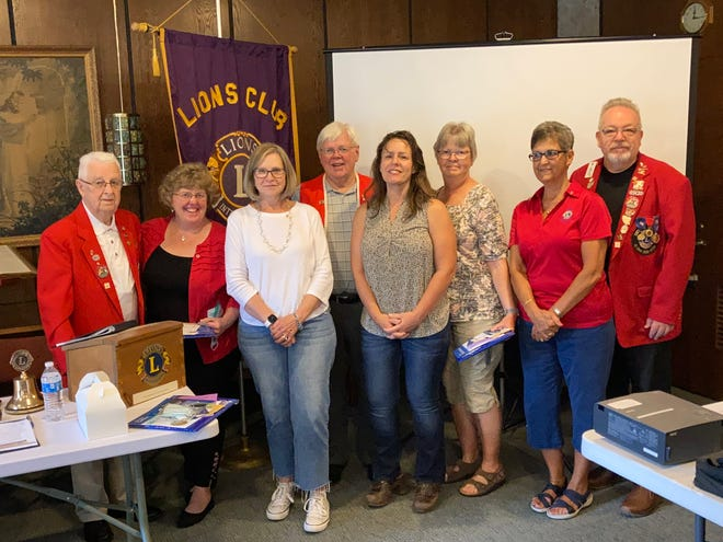 At a recent membership event hosted by Membership Chair Doug Long and Missy Harmon, four attendees completed applications to be members. Recently they were inducted by Kent Lion Leo Lux. From left are Leo Lux, new members Paula Lovinski, Laurel Stillerand Dianne Nahas and their sponsor Doug Long (back), Nancy Wachsmuth with her sponsor Jane Gwinn and Lions PresidentTony Deluke. All new members are from Kent.
