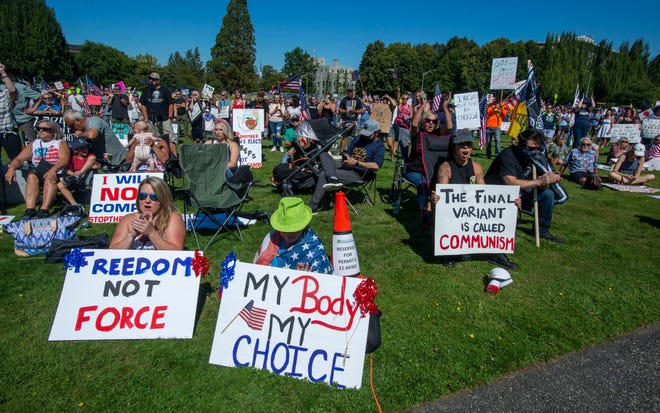 People gather outside the Capitol to protest Gov. Jay Inslee's vaccine mandate for state workers on Saturday, Aug. 28, 2021, in Olympia, Wash.