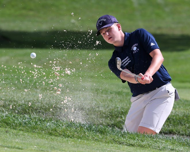 Zach Root of Louisville hits from the sand trap on the 15th hole during the Congress Lake Invitational on Monday.
