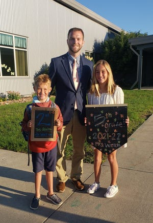 St. John Lutheran School principal Todd Brassow welcomed Camden and Tenley Wertich to the first day of school on Monday, Aug. 30.