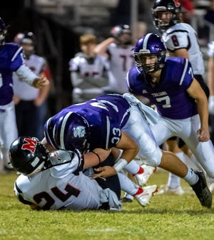 Southeast of Saline linebacker Matthew Rodriguez lays out Patrick Smith of Marysville during last year's Class 3A playoffs.