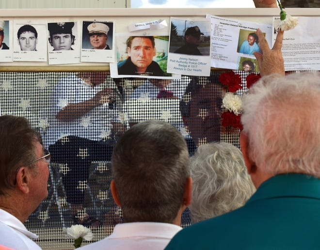 A bulletin board which both featured a place for people to place memorabilia related to the victims of the 9//11 terrorist attacks offered one of the more poignant experiences during the 15th anniversary memorial ceremony at Sarasota National Ceremony. The board also included a flag where early participants could place either a red or white carnation into a an American Flag.