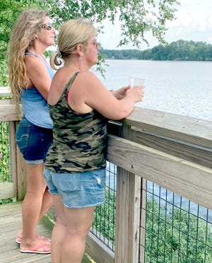 Chance Hussey and Nancy Frohriep take in a view of St. Joseph River at Covered Bridge Farm Park.