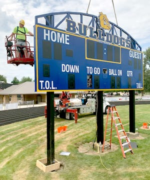 Paul Hoppenrath, a master electrician with Universal Sign Systems of Grand Rapids, puts the finishing touches on a new scoreboard Aug. 26 at Centreville High School's football field. The district also has two new gymnasium scoreboards for basketball, volleyball and wrestling.