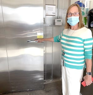 The forensic cooler atWestern Michigan's Homer Stryker School of Medicinehas capacity for more than 30 bodies. Joyce deJong is the medical examiner of 13 counties, including St. Joseph County.