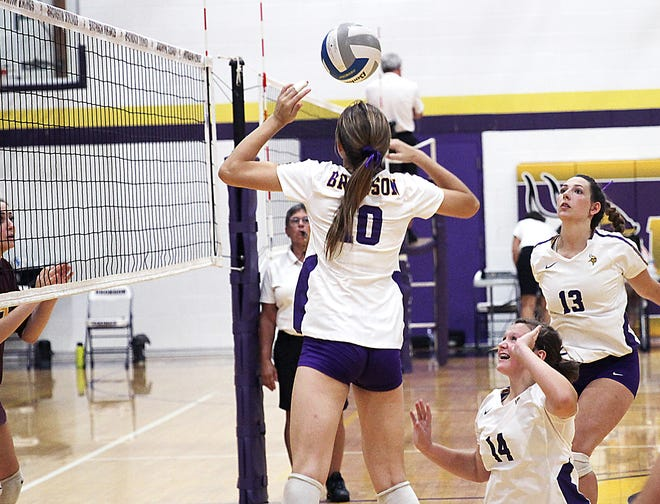 Bronson's Brealyn Lasky sets up a ball for Aubree Calloway for a kill at the Bronson mini invite on Saturday.