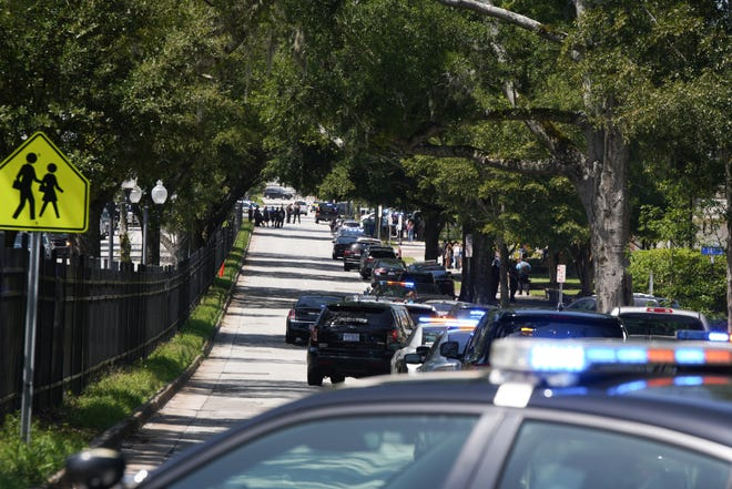 Law enforcement from multiple agencies  responded to a shooting Monday morning at New Hanover High School. One student was shot by another inside the school.  [KEN OOTS/FOR STARNEWS]
