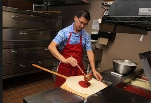Restaurant owner Roberto Quinonez makes a pepperoni pizza with fresh dough, recipe sauce and toppings at Paula's Pizza.