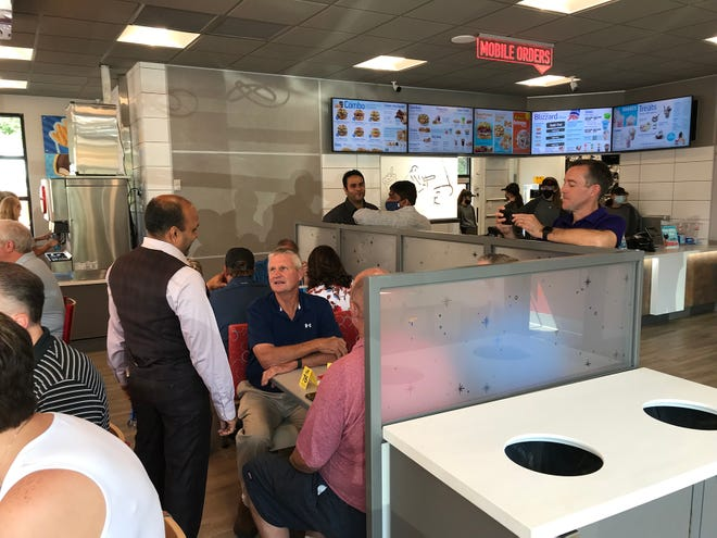 """Raj Patel, left, owner of Pittsburg's new Dairy Queen, talks with Rep. Chuck Smith (R-Pittsburg) at the restaurant's """"VIP Lunch"""" on Saturday prior to its opening this week."""