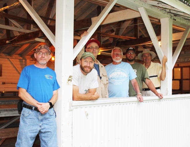 The Kingwood Picnic celebrates 100 years on Saturday as part of a community tradition. Independent Order of Odd Fellows Kingwood Lodge 1010 members pictured here are (from left): Doug Close, Mark Millin, Allan Burnworth, Dave Tannehill, Charlie Groff and Everett Sechler. They are standing in the old pavilion built from used lumber when the Markleton Sanatorium was razed in the 1920s.