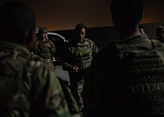 Maj. Gen. Christopher Donahue, the 82nd Airborne Division commanding general, speaks with Paratroopers at Hamid Karzai International Airport in Kabul, Afghanistan, Aug. 25. The 82nd helped facilitate the safe evacuation of U.S. citizens, Special Immigrant Visa applicants, and other at-risk Afghans out of the country as quickly and safely as possible.