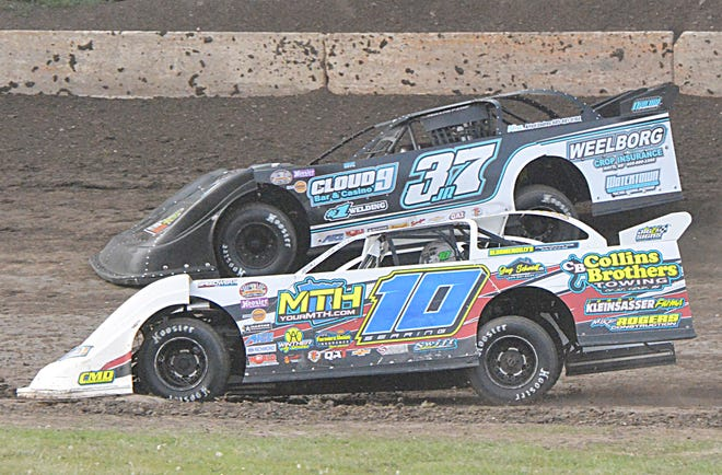 Huron driver Cole Searing (10), show battling Watertown's Morgan Ward (37JR) during a late model heat race this season, won his third late model feature of the season Sunday night at Casino Speedway.