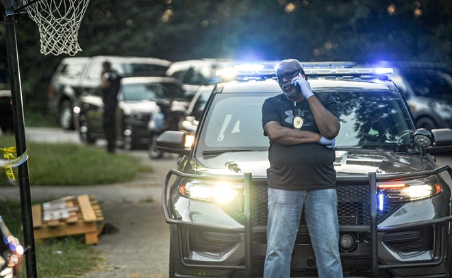 Charlie Boseman, left, Anderson County Deputy Coroner is on the phone near Anderson County Sheriff deputies and investigators at a home on Woodmont Circle in Anderson, where a man was shot in a domestic incident Sunday, August 29, 2021.
