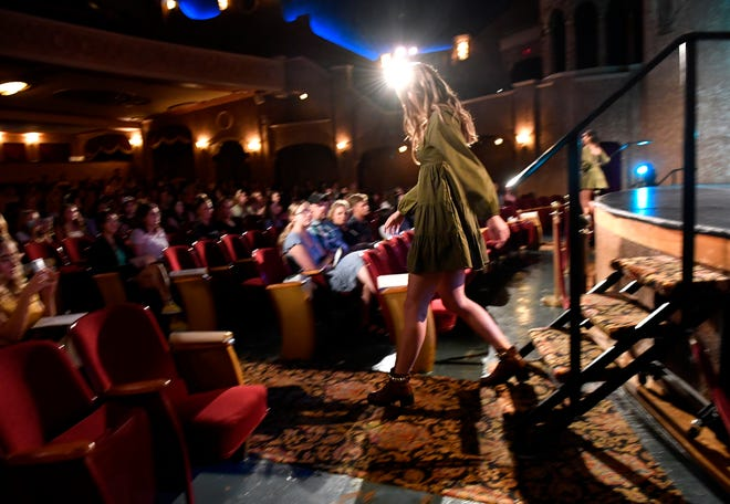 A model steps into the audience during Karson's Fashion Show on Friday at the Paramount Theatre.