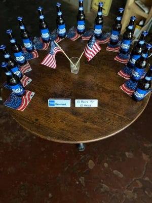 The Green Kayak is among restaurants in Greater Cincinnati who reserved a table and placed 13 beers in honor of service members killed in the Kabul airport bombing last week.