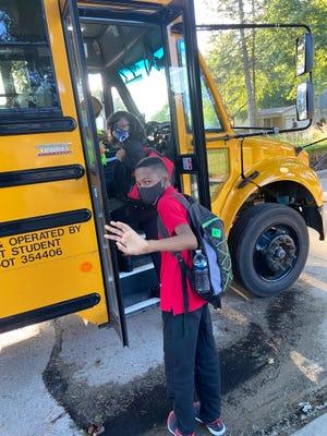 Columnist Darren Nichols' children head off to school on Monday, Aug. 30.