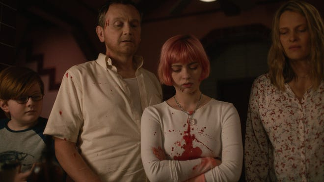 """From left: John James Cronin, Pat Healy, Sierra McCormick and Vinessa Shaw in a scene from """"We Need to Do Something."""""""