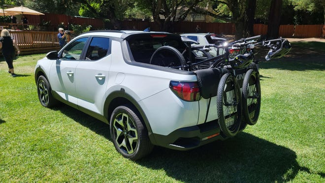 You can stash bikes on the bed of the 2022 Hyundai Santa Cruz - just make sure you have something to protect the tailgate from the front tire hanging over the back.