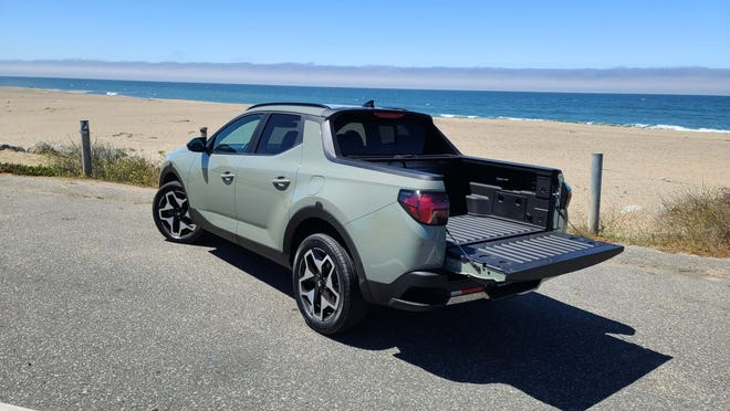 The bed of the 2022 Hyundai Santa Cruz is perfect for surfboards and other quick trips around town.