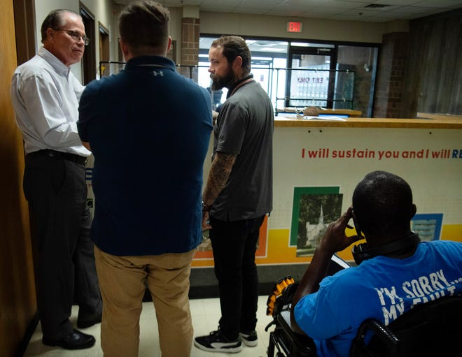 U.S. Sen. Mike Braun, left, speaks with employees at the Evansville Rescue Mission, Nate Denning, center, and Phillip Boyd during a tour of the facility Monday morning, Aug. 30, 2021.