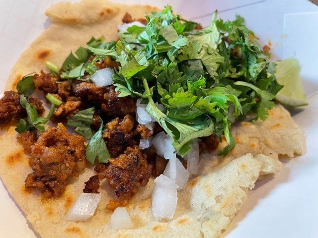 Street tacos at Paco's Tacos are served on homemade corn tortillas, with flour tortillas available on request.