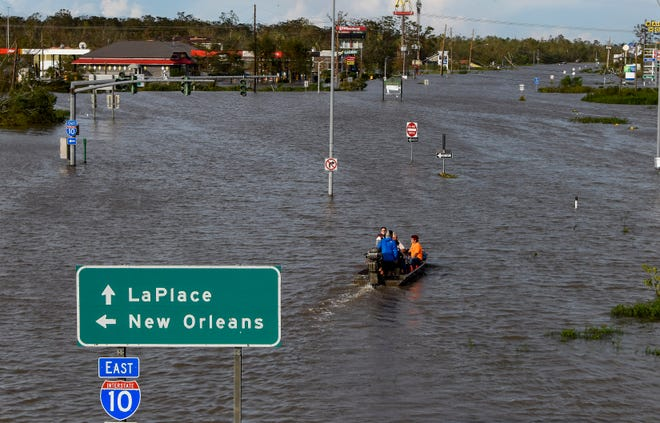 Highway 51 is flooded near LaPlace, La., on Monday morning August 30, 2021, after Hurricane Ida came ashore in Louisiana on Sunday August 29, 2021.