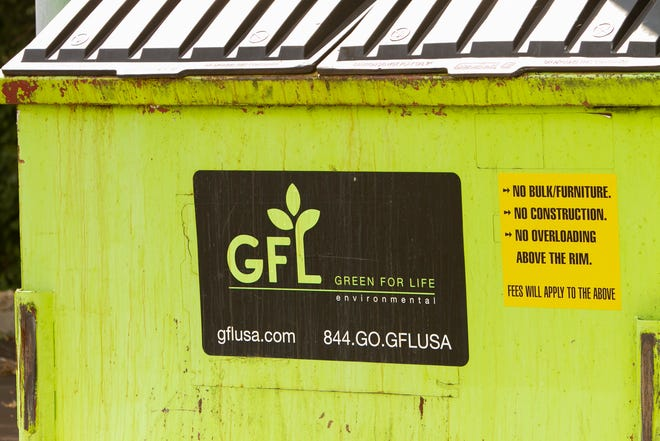 A Green For Life Environmental dumpster sits behind the First Presbyterian Church of Brighton Monday, Aug. 30, 2021.