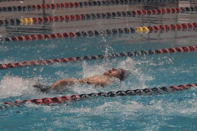 Justin Hale competes in the 50-meter backstroke.