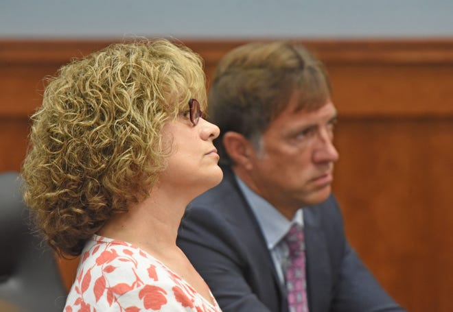 Cara Welty, seated with attorney James Mayer III, pleads guilty Monday morning to three counts of cruelty to companion animals.