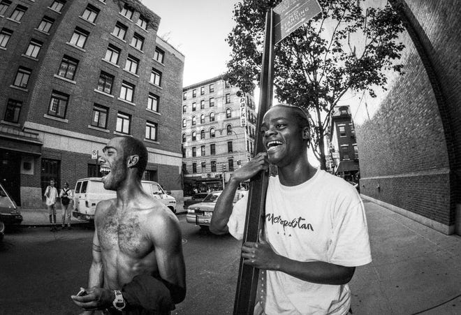 """Mike Hernandez and Harold Hunter share a happy moment in """"All the Streets Are Silent,"""" showing at the 2021 Cultures & Communities Festival."""