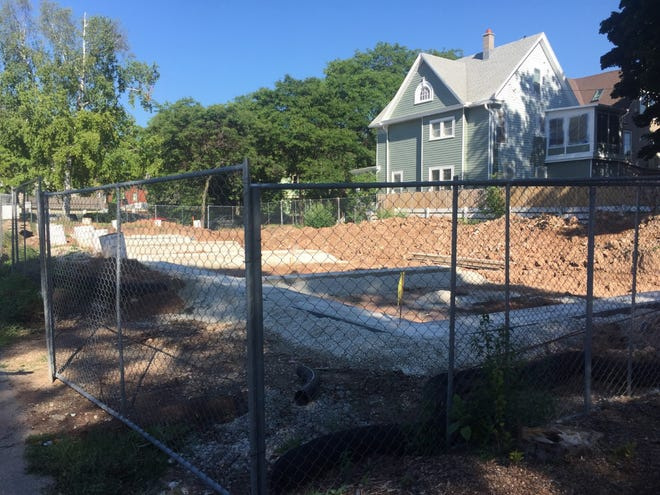 Construction has started on four townhomes at North Downer Avenue and East Park Place, one of two small apartment developments in the neighborhood.