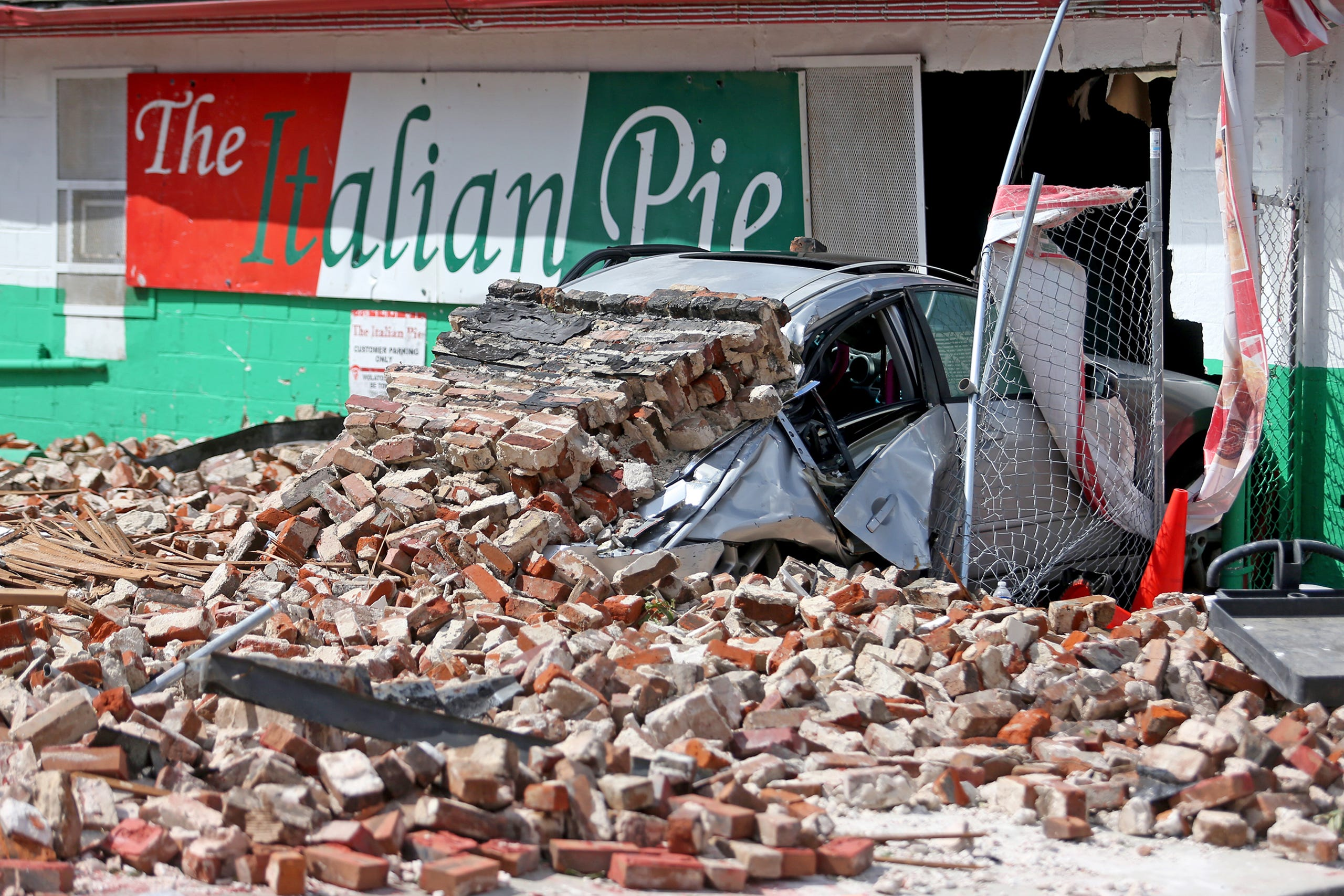 A car at a neighboring restaurant was crushed by debris from the collapse of the historic Karnofsky Store on South Rampart Street in New Orleans, a second home to jazz musician Louis Armstrong destroyed by Hurricane Ida. Photographed on Monday, August 30, 2021.