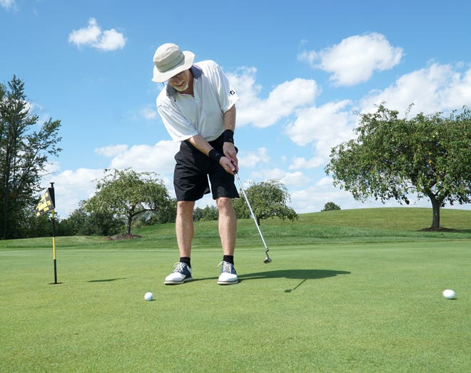 Bob Davis of Canton warms up on the Summit's Pheasant Run Golf Course on Aug. 30, 2021. The Canton course has reported a significant increase in revenues in the last year as many more golfers have hit the links.